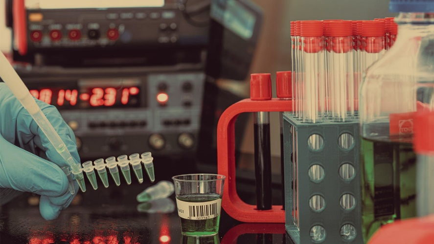 A technician prepares blood samples for mass spectrometry